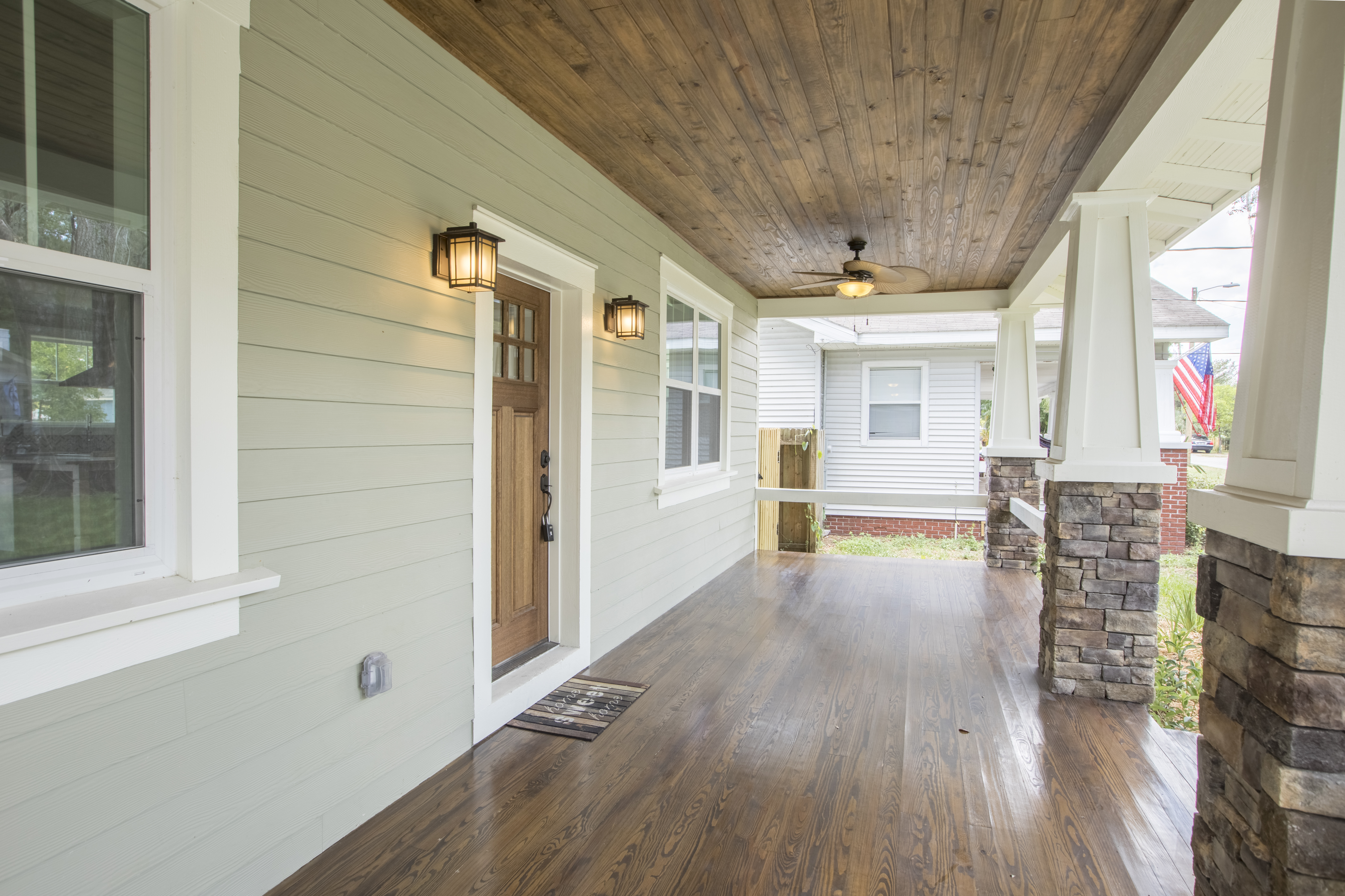 side angle of front porch with wooden flooring